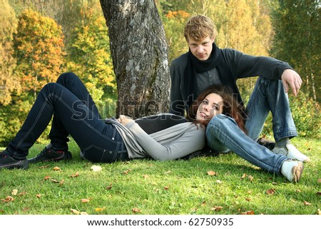 beautiful couple having fun in autumn park - stock photo