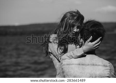 beautiful couple having fun on the lake - stock photo