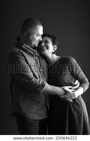 Beautiful couple hugging, monochrome - stock photo