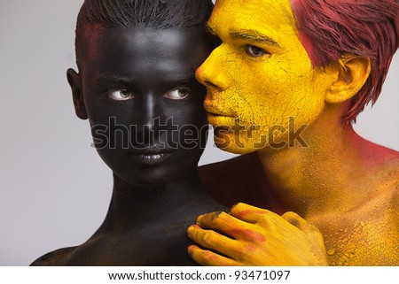 beautiful couple hugging people in the paint bodyart