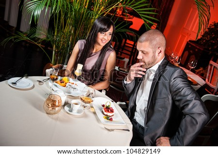 Beautiful couple in a restaurant on romantic date - stock photo