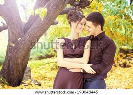 Beautiful couple in autumn park - stock photo
