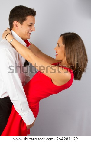 Beautiful couple in classical outfits. - stock photo