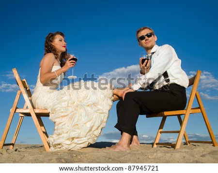 beautiful couple in front of the blue sky - stock photo
