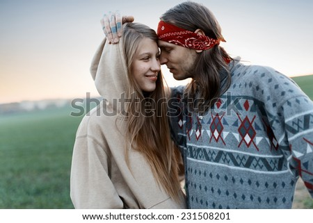 Beautiful couple in love at sunset hipsters - stock photo