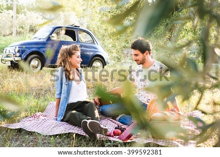 Beautiful couple in love having a picnic