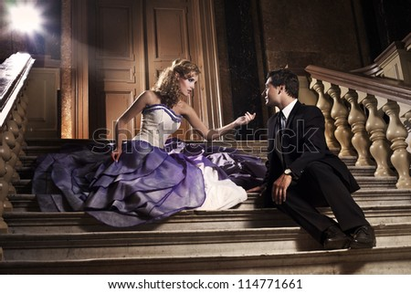 Beautiful couple in love having date in historical mansion - stock photo