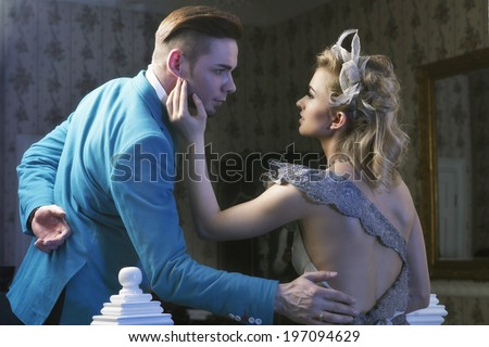 Beautiful couple in love in luxury apartment - stock photo