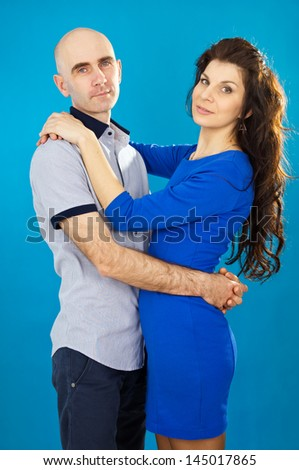 Beautiful couple in love on a blue background
