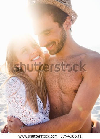 Beautiful couple in love on the beach