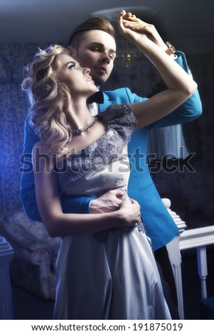 Beautiful couple in love - romance in luxury apartment - stock photo