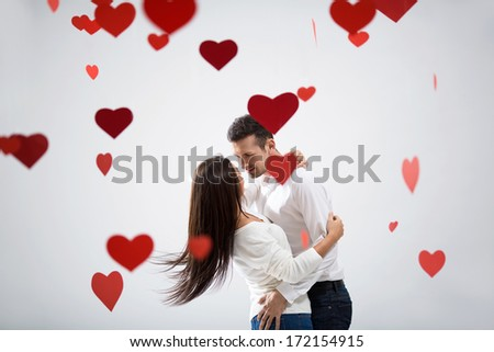 Beautiful couple in love with hearts - stock photo