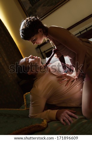 Beautiful couple in the bedroom - stock photo