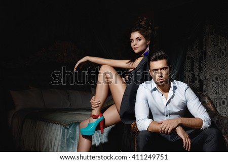 Beautiful couple in the  luxurious room at night