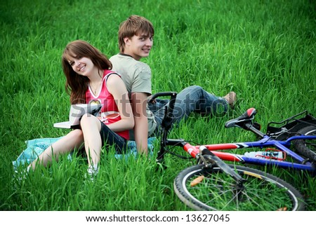 Beautiful couple lying on the grass - stock photo