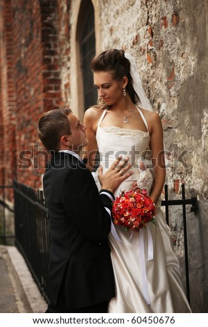 beautiful couple near old chapel - stock photo