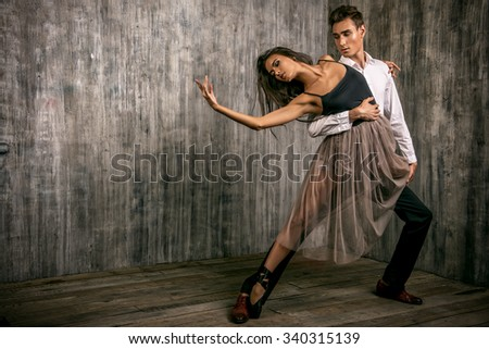 Beautiful couple of ballet dancers dancing over grunge background. Beauty, fashion.  - stock photo