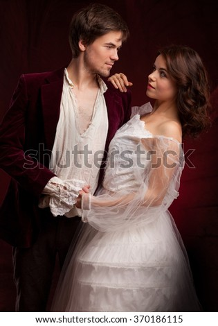 Beautiful couple of vampires dressed in medieval clothing. Halloween.  - stock photo