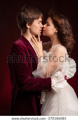 Beautiful couple of vampires dressed in medieval clothing. Halloween. Book cover  - stock photo