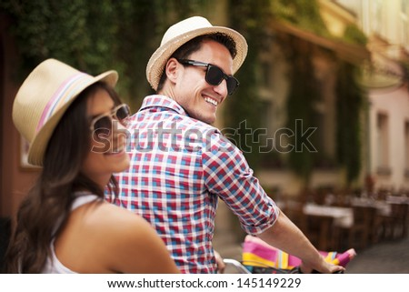 Beautiful couple on bicycle in the city   - stock photo