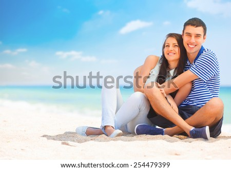 Beautiful couple on the beach. - stock photo