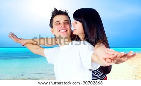 Beautiful couple on the sunny tropical beach - stock photo