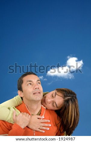 beautiful couple over white - he is looking away while she has her eyes closed - stock photo