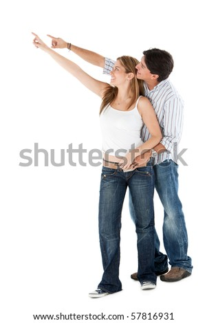 Beautiful couple pointing - isolated over a white background