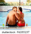 beautiful couple relaxing in the swimming pool - stock photo
