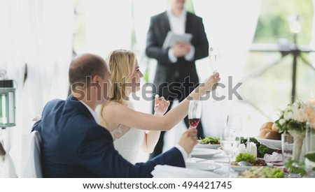 beautiful couple sitting together at a table in a restaurant
