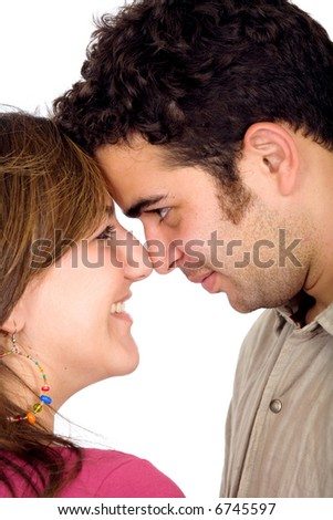 beautiful couple smiling and facing each other - isolated over a white background
