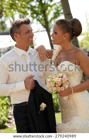 Beautiful couple smiling happy on wedding-day. - stock photo