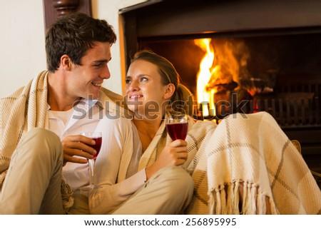 beautiful couple spend romantic evening drinking wine - stock photo
