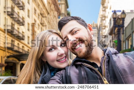 Beautiful Couple taking a selfie photo in San Francisco, USA - stock photo