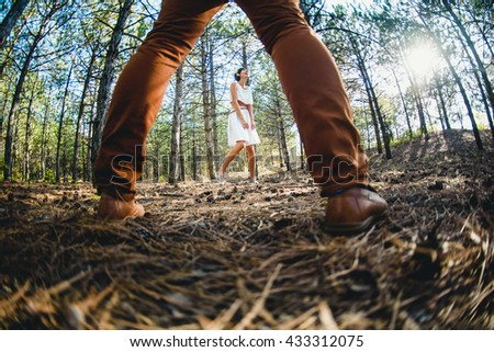 Beautiful couple walking in the forest