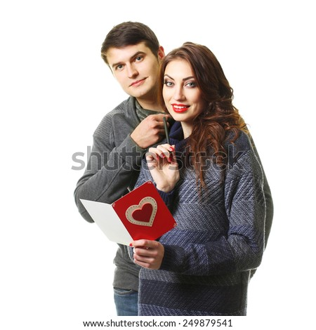 beautiful couple with a card on Valentine's Day - stock photo