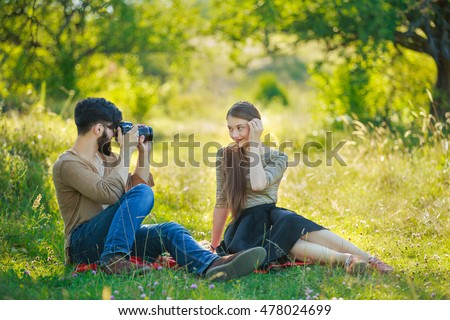 beautiful couple with camera
