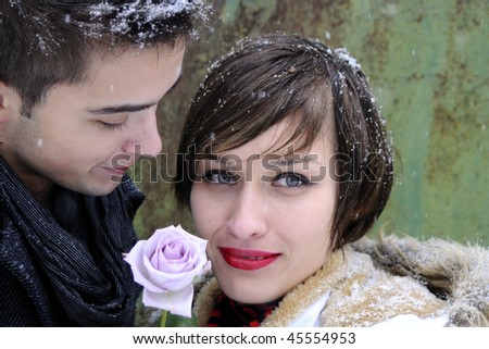beautiful couple with purple rose - stock photo