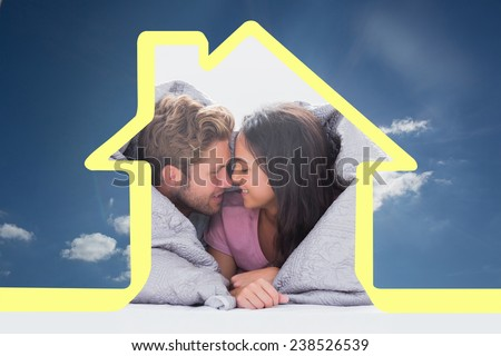 Beautiful couple wrapped in the duvet against cloudy sky with sunshine - stock photo