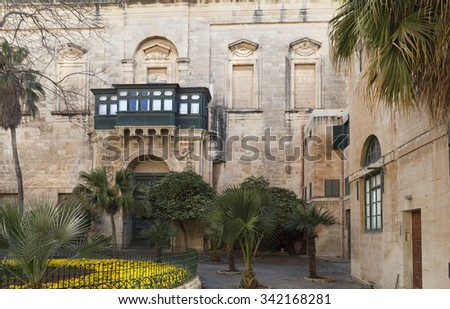 Beautiful court interior with a building facade and balcony - stock photo