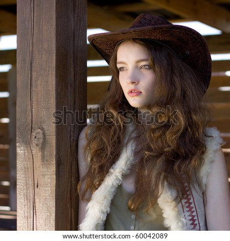 beautiful cowgirl in hat close-up portrait - stock photo