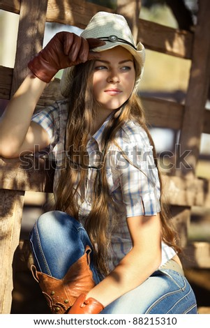 Beautiful cowgirl in stetson - stock photo