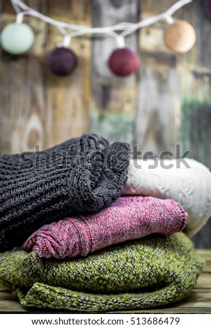Beautiful cozy warm sweater on a wooden background