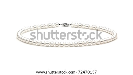 Beautiful creamy pearl necklace on a white background - stock photo
