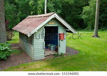 Beautiful creative handmade garden play toy house for kids in a backyard                                  - stock photo