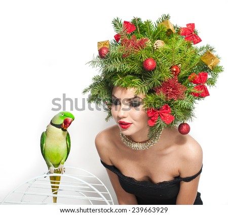 Beautiful creative Xmas makeup and hair style indoor shot.  - stock photo