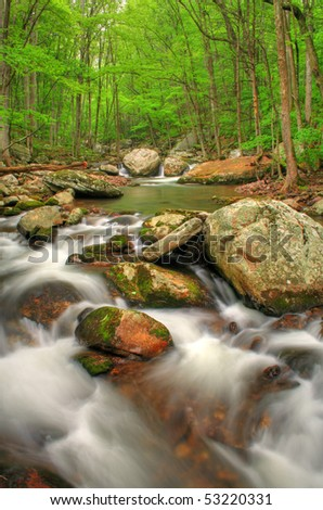 Beautiful creek right after a Spring rain with lots of boulders. HDR image. - stock photo