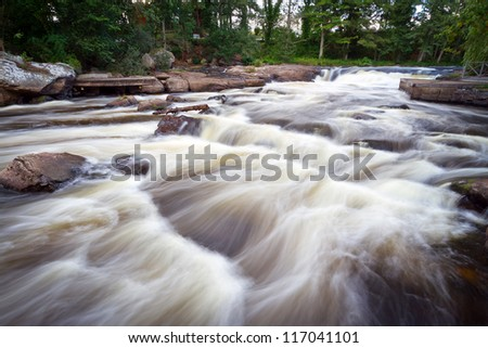 Beautiful creek with cascades in southern Sweden - stock photo