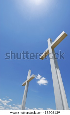 Beautiful cross statues under sunny blue sky