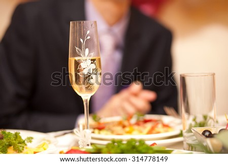 Beautiful crystal decorated glasses with champagne on the wedding day - stock photo